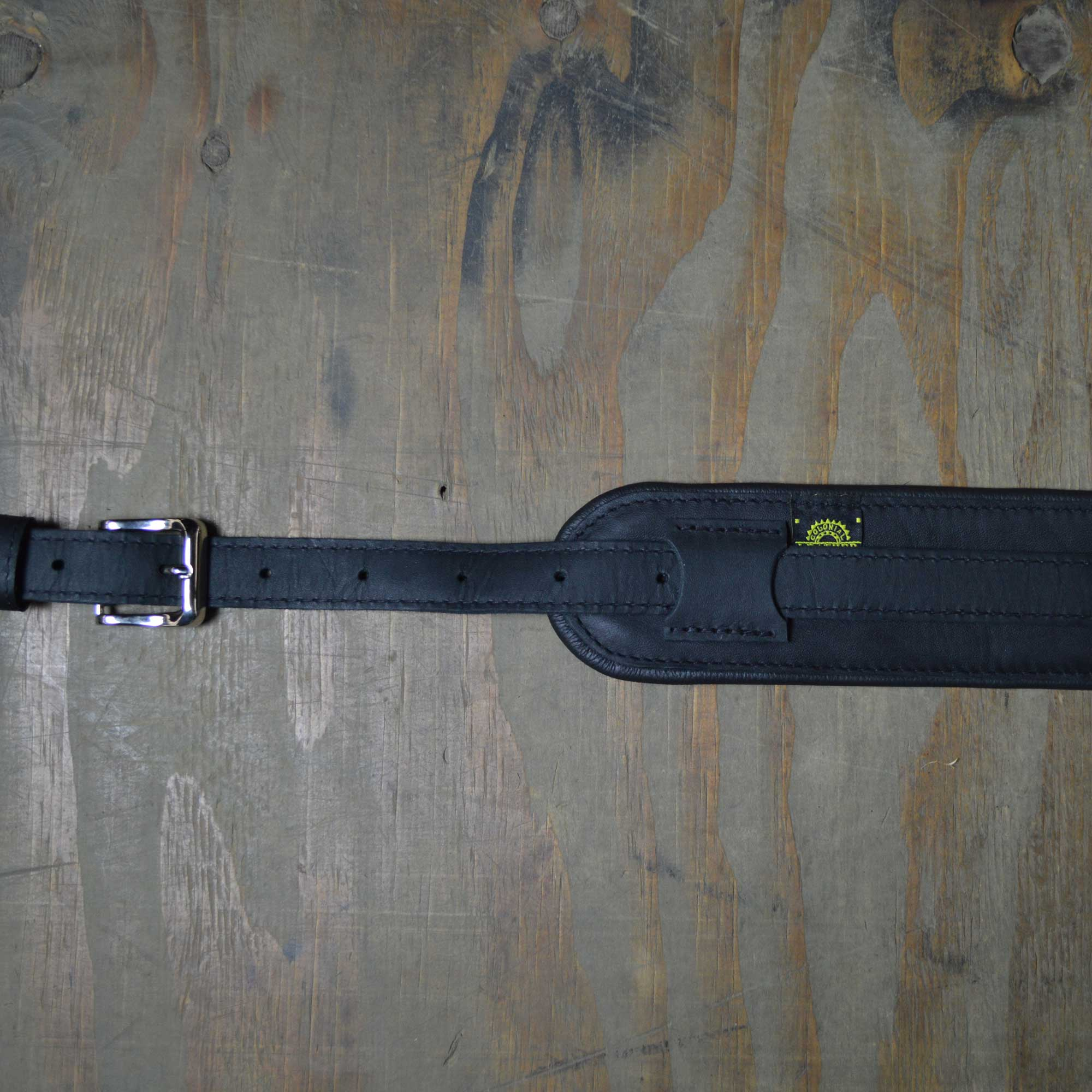 Vintage style guitar strap made with a topgrain leather top and an upholstery backing. Black & Black